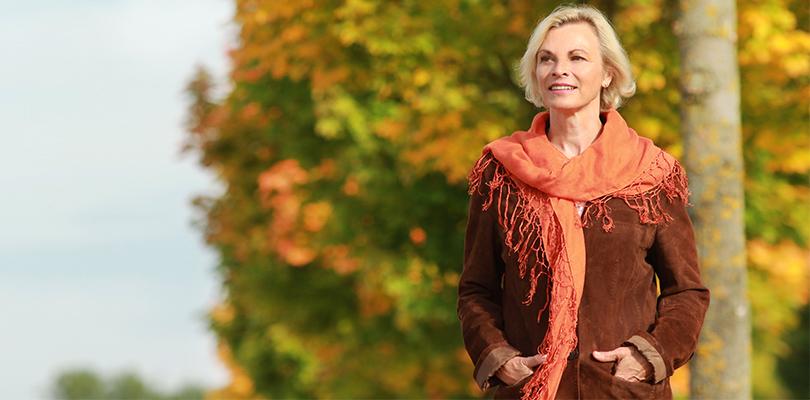Older woman walking outside on a fall day
